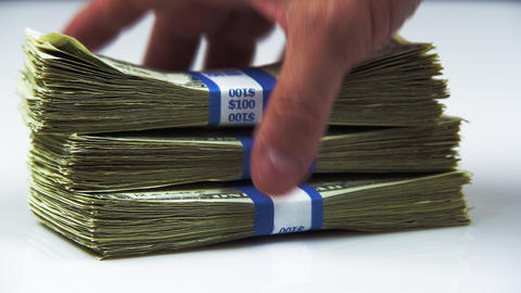 Shot of a hand grabbing a bundle of American currency Footage