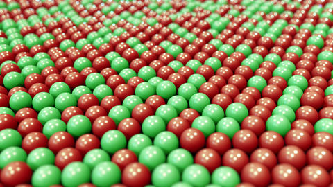 Swaying red and green plastic balls. Loopable motion background Footage