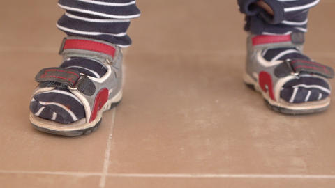Cute little feets of the small kid in slow motion and stripes Footage