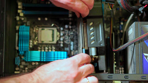 Close-up of male hand uninstalling videocard in PC Footage