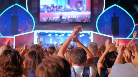 People silhouette partying and clapping at night electronic music concert Footage
