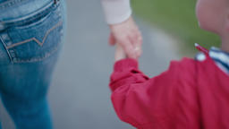 Parent and Kid Hands: Mother is Leading Little Son Boy by Hand in the Park Footage