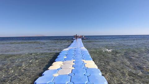 Pontoon bridge in the red sea in slow motion Archivo