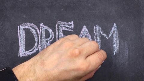 Word dream, written with chalk on blackboard Footage