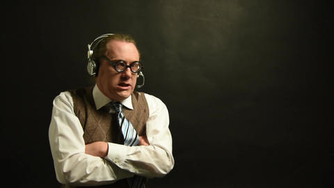 Angry nerd with headset on the phone at the call center Footage