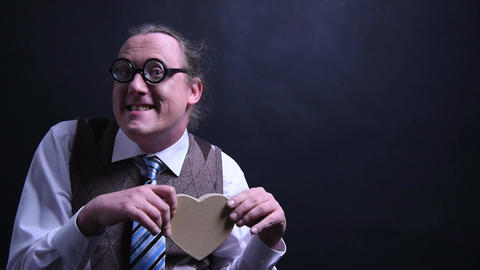 Amorous nerd with a heart as a gift Footage