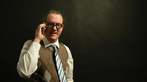 Nerd Boss calls on his mobile phone Footage