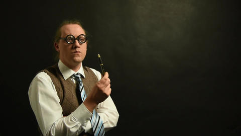 Pensive nerd boss with pen is thinking Live Action