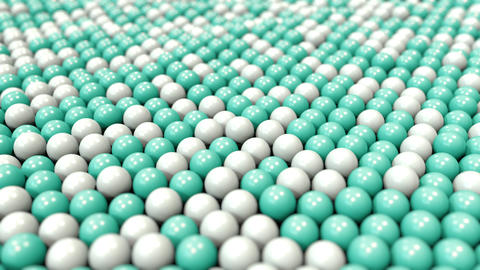 White and cyan plastic balls, loopable motion background Footage
