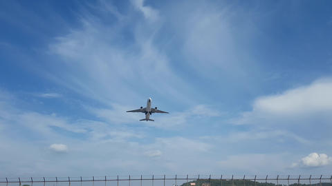 Airliner takes off against a blue sky and bright sun Footage