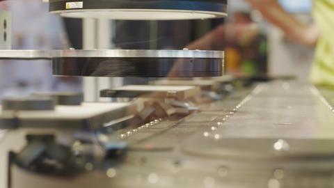 Automatic test set scanning details on conveyor belt in lab Live Action