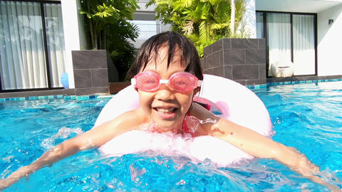 cute girl in swimming pool Live Action