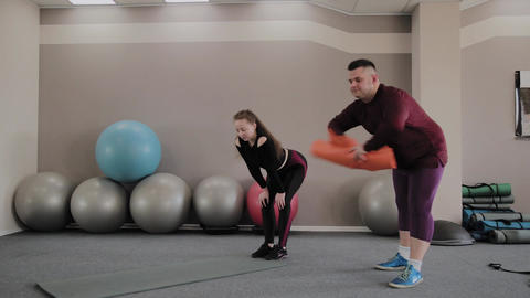 Fat man woman train in gym together Footage