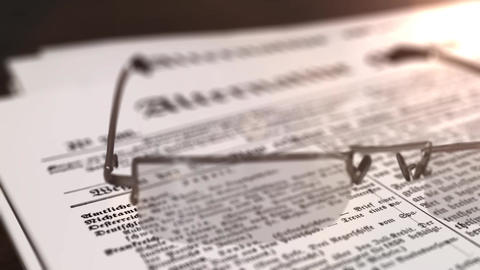 glasses with newspaper with the headline Alternative Media on a table Animation