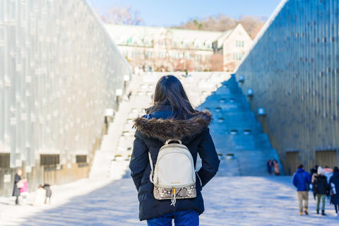 Young asian woman traveler with backpack traveling into the Ewha Womans University in Seoul, South Photo
