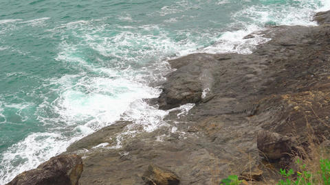 the waves of the sea with turquoise water. the waves break on the rocky shore Footage