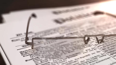 glasses with newspaper with the headline Politics on a table Animation