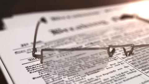 glasses with newspaper with the headline Breaking News on a table Animation