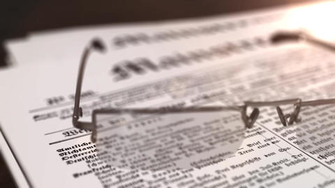 glasses with newspaper with the headline Mainstream on a table Animation