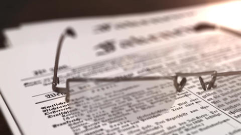 glasses with newspaper with the headline Fakenews on a table Animation