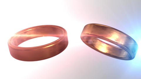 2 golden wedding rings that merge together with beautiful grey bokeh background Animation