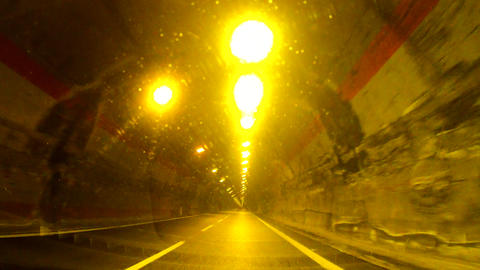 Driving The Car In A Small Illuminated Tunnel 0