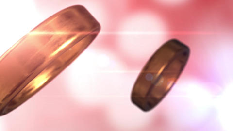 2 golden wedding rings that merge together with beautiful... Stock Video Footage