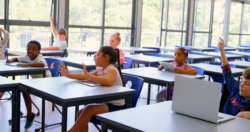 Schoolkids raising hands in the classroom at school 4k Live Action