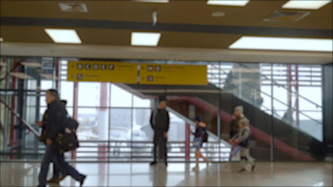 People at the airport. Airport terminal, people pass near the escalator Footage