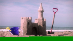 (1001) Sandcastle on the Beach with Toys Stock Video Footage