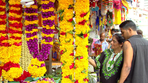 Indian Mother And Son Buying Flowers Footage