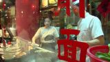 Chinese Knife Cut Noodle Stall stock footage