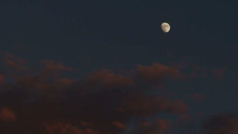 1050 Summer sunset and full moon time lapse Stock Video Footage
