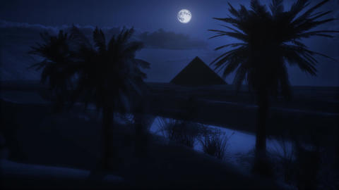 1073 Full moon night pyramid oasis Stock Video Footage