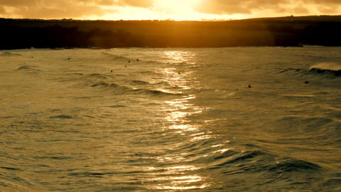 Sunset Surfers Stock Video Footage