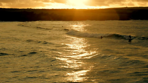 Sunset Surfers stock footage