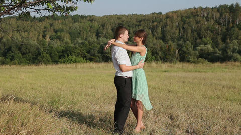 Young couple hugging on the yellow grass Footage