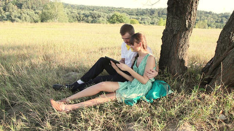 Young couple browsing in Internet with tablet and chating Stock Video Footage