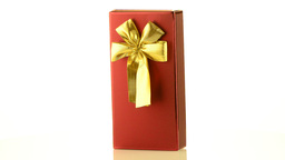 Red box with gold bow Stock Video Footage