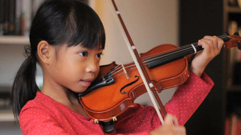 Asian Girl Practices Her Violin Stock Video Footage