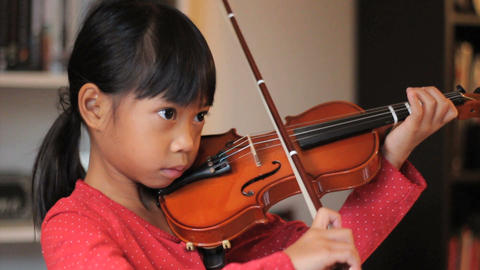 Asian Girl Practices Her Violin Footage
