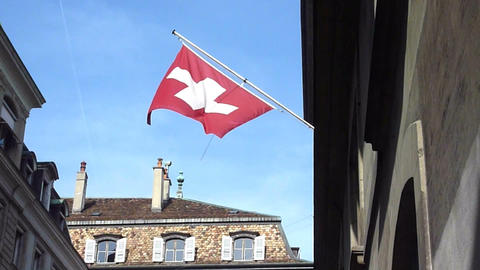 Swiss flag in old town, Geneva Stock Video Footage