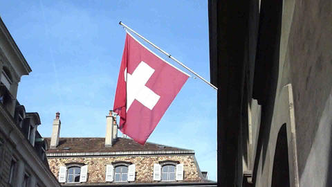 Swiss flag in old town, Geneva Footage