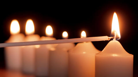 Lighting a candle Stock Video Footage