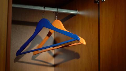 Swinging hangers in a wardrobe Footage