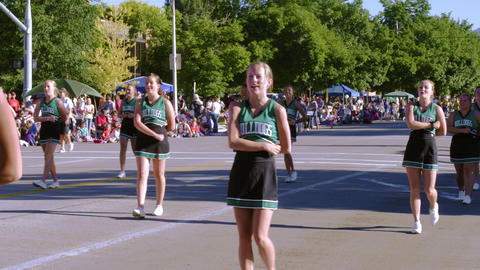 Cheerleaders in a parade Footage