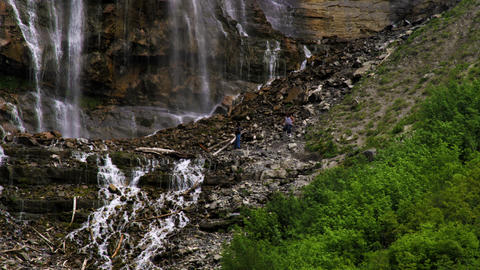 People on a hillside of Bridal Veil Falls in Provo, Utah Footage