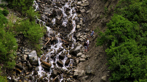 Youth climbing up rocks near Bridal Veil Falls in Provo, Utah Footage