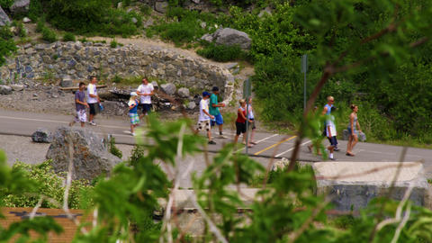Teenagers walking along a path at Bridal Veil Falls in Provo, Utah Footage