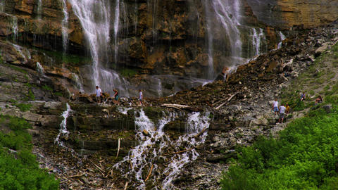 People climbing at the base of Bridal Veil Falls in Provo, Utah Footage